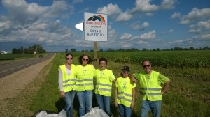 Picture of E & H team on highway after picking up trash as part of Adopt a Highway project.